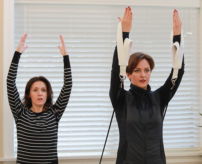 Women doing Pilates during a Duet Pilates session