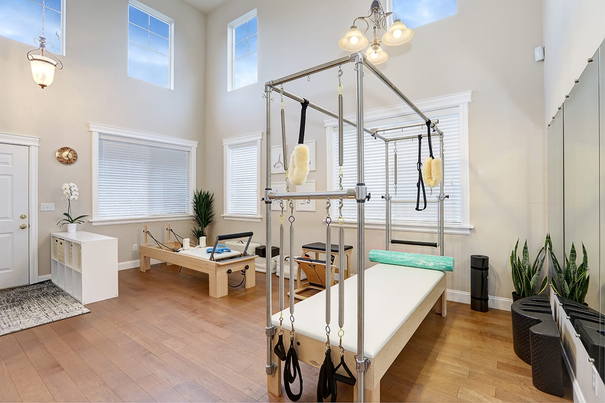 Beautiful light Pilates studio equipped with Reformer, Cadillac, Chair and other small equipment