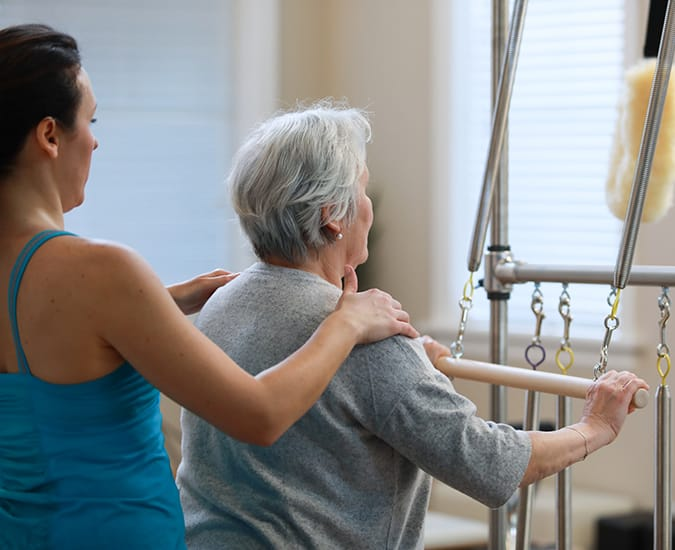 Pilates instructor teaching a cliebt during a private Pilates session in Sammamish WA